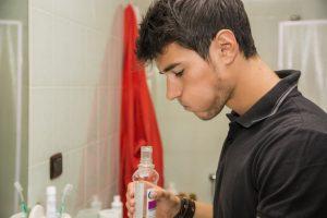 Man gargling mouthwash