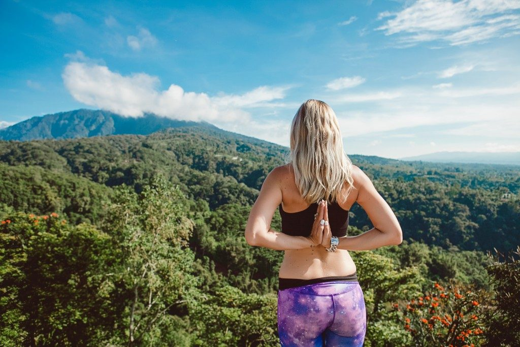 Woman doing yoga with a view