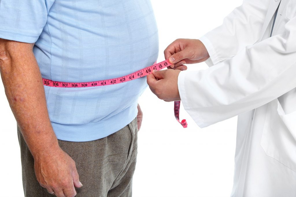 Doctor measuring patient's waist