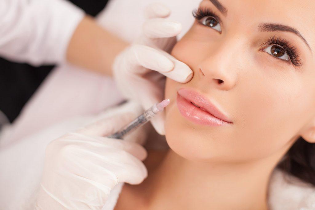 woman having a shot of botox