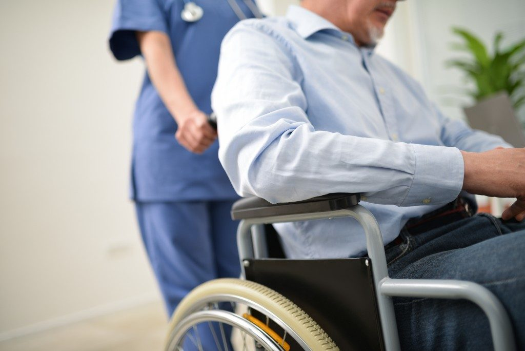 Nurse pushing the patient's wheelchair