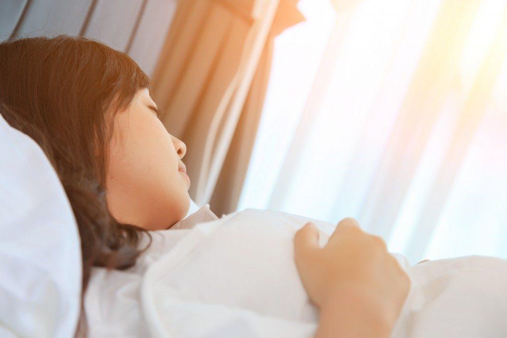 Teen sleeping comfortably