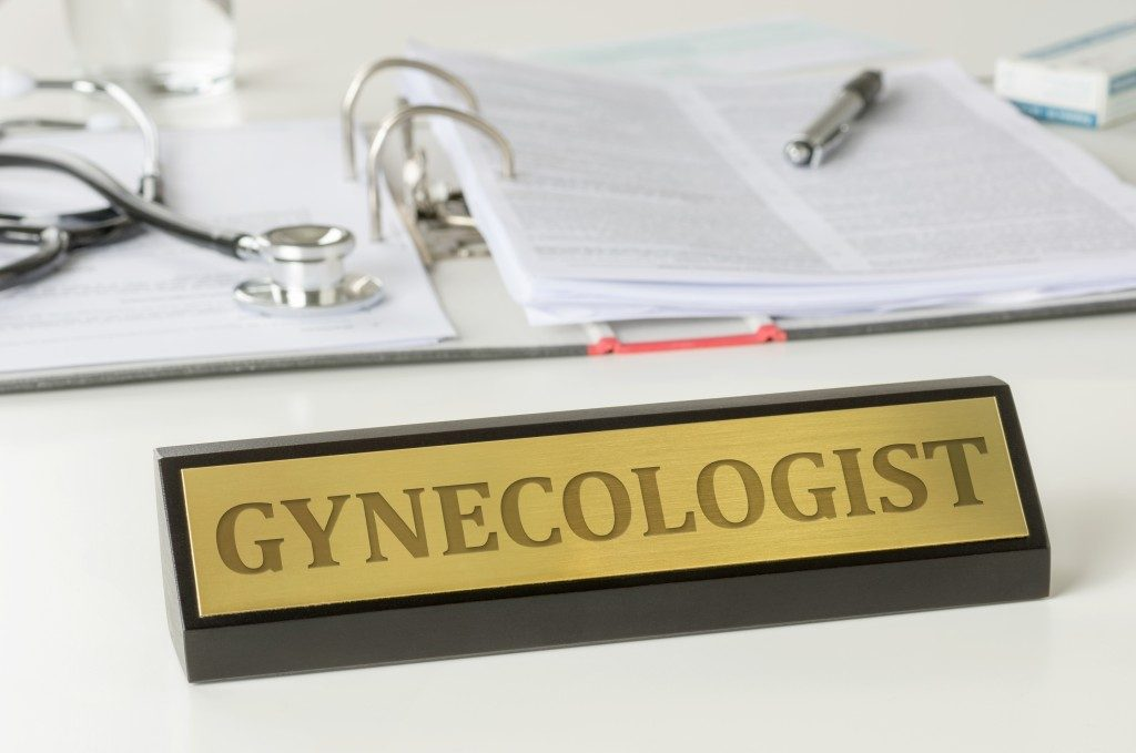Name plate on a desk with the engraving Gynecologist