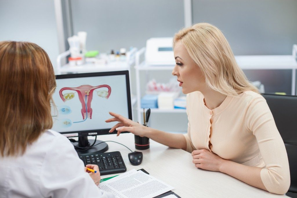 blond girl is consulting with gynecologist