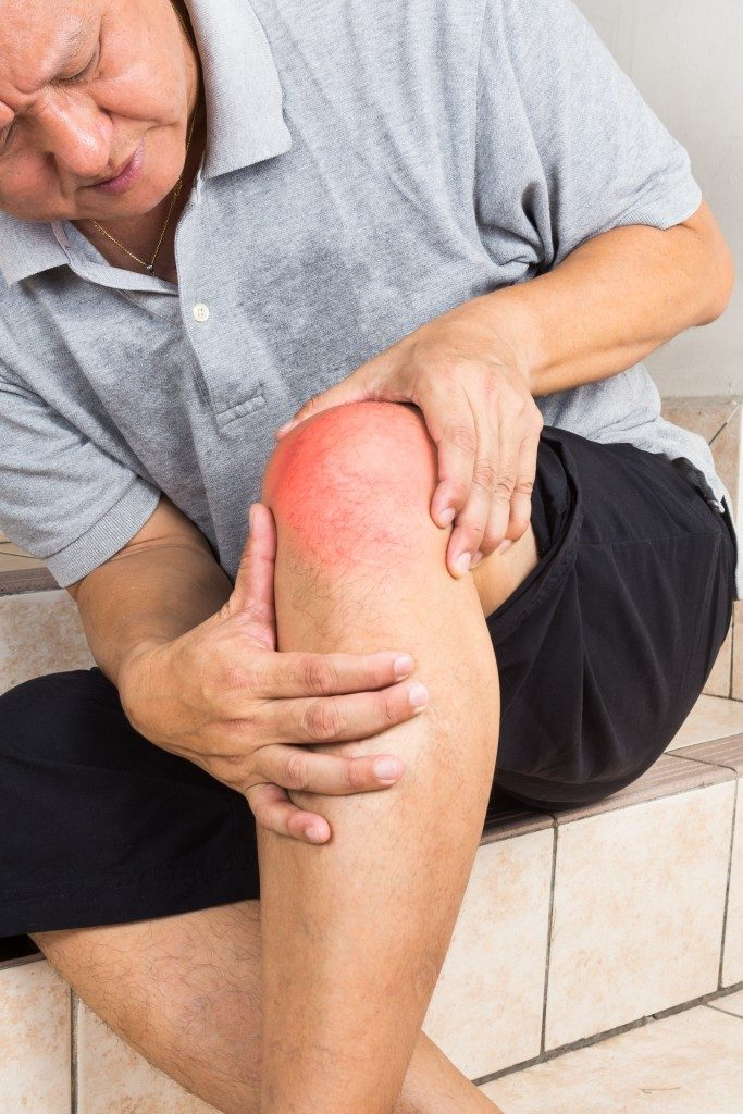 old person with hurt knee