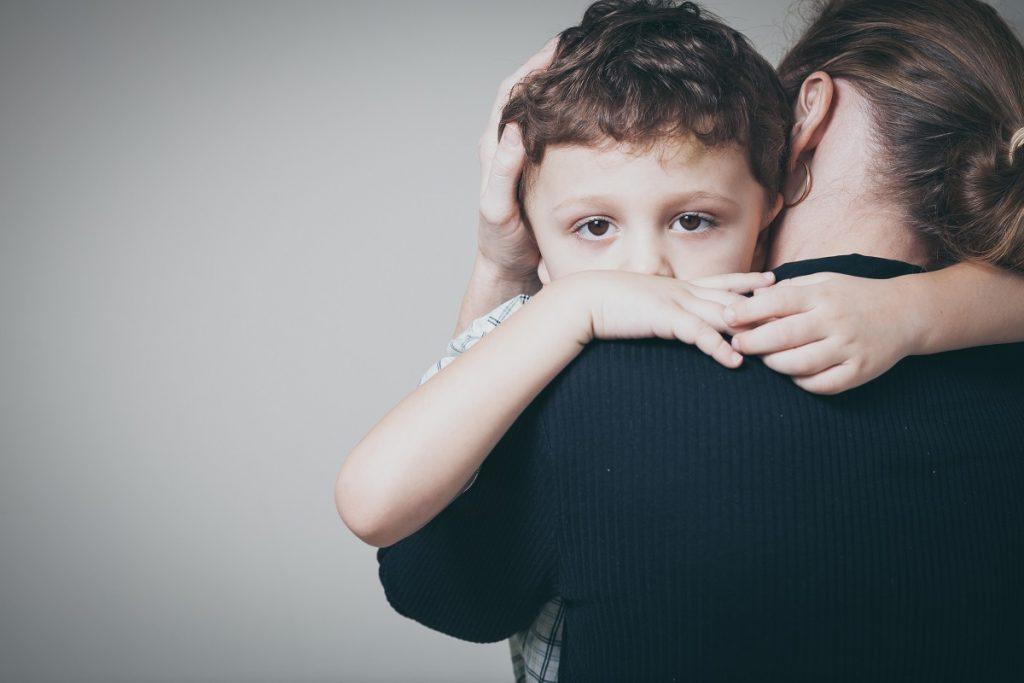 Sad son hugging his mother
