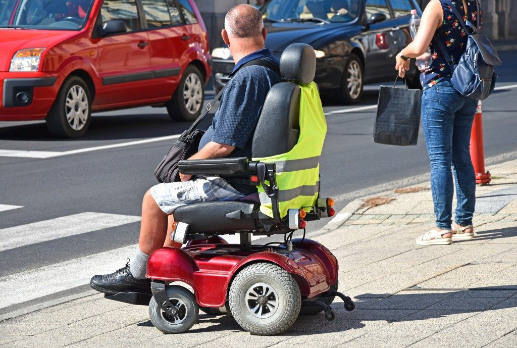 man using an electric wheelchair