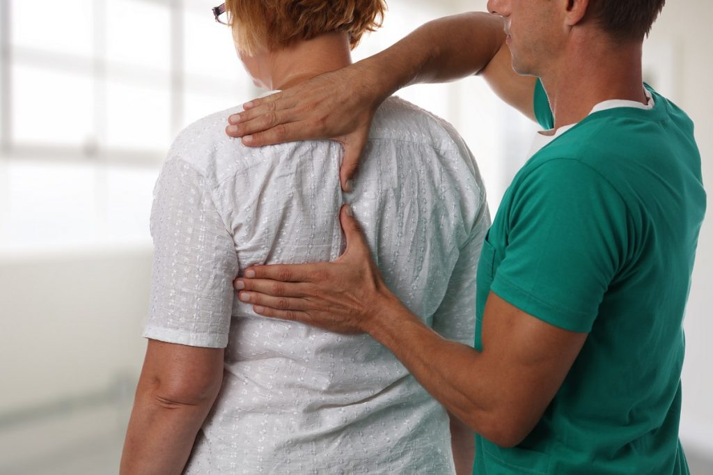 woman being treated for back pain