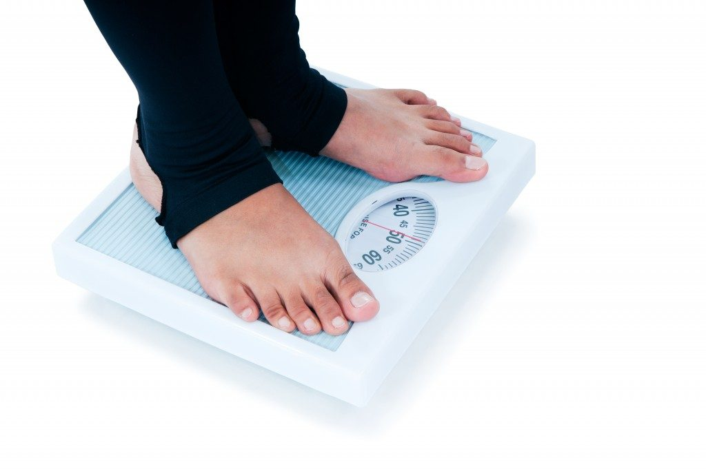 weighing scale being used
