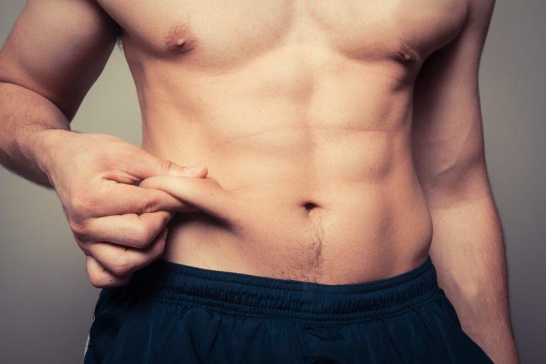 fit man pinching skin