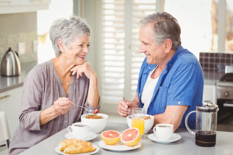 an old couple having breakfast