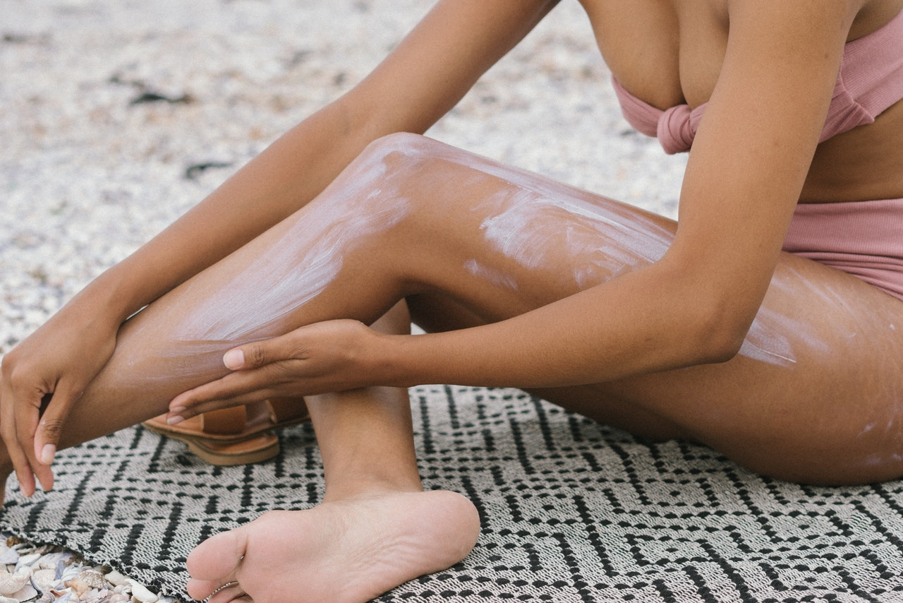 woman applying sunblock lotion